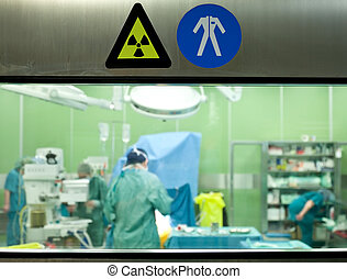 Warning signs busy surgery
