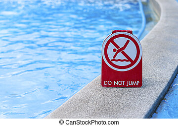 Warning signs, do not jump into this area of the pool.