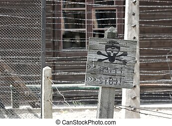 Warning - Skull sign warns about danger, electric fence