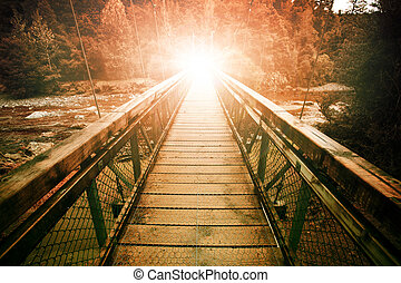 warp light at the end of suspension bridge crossing steam in...