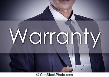 Warranty - Young businessman with text - business concept