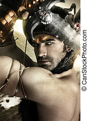 Warrior in action - Portrait of a sexy male model as ancient...