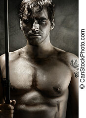 Warrior - Classically styled portrait of a shirtless young...