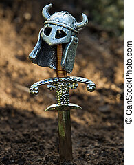 Type of warrior's grave with a sword and helmet instead of the cross.