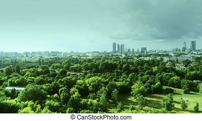Warsaw cityscape behind the park, aerial shot - Warsaw...