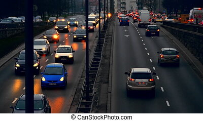 Warsaw, Poland- December 26, 2017 Evening traffic in the city of Warsaw. Cars are slow going.