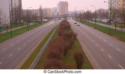 Morning traffic on the road in a sleeping district in the city of Warsaw.