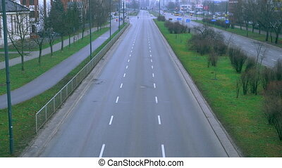 The sleeping neighborhood is an empty road, sometimes cars...
