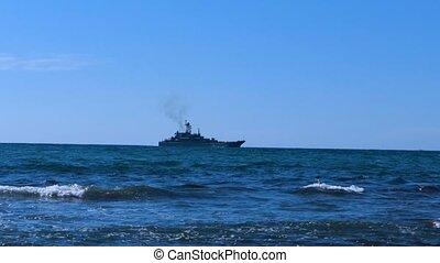 Warship on the sea horizon - Warship sailing along the shore...