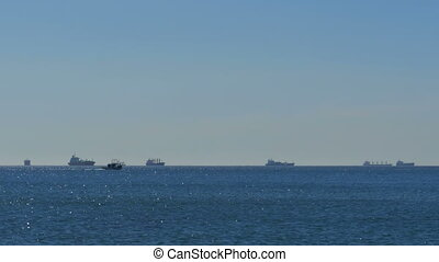 Warships, barges and boats in the sea near the border of Gibraltar, Spain