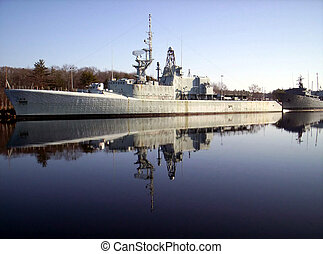 warships reflection, old derelict warships tied to wharf...