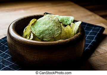 Wasabi Chips in a wooden bowl.