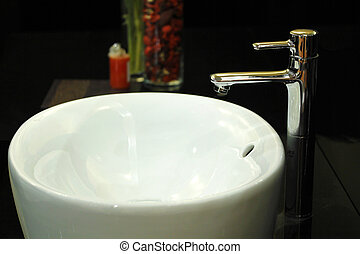 Wash Basin - A white wash basin with contemporary tap
