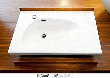 Wash basin - Ceramic wash basin in bathroom with wood