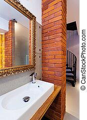 Wash basin - Closeup of a wash basin and a mirror in...