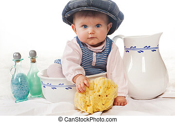 Wash basin funny baby - Four months old baby with cap in a ...