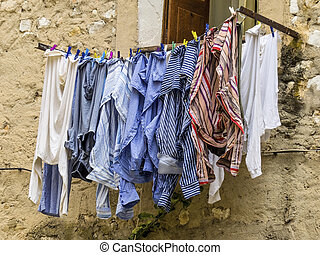 washing on the line in front of a window