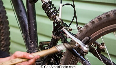 Wash the bicycle shock absorber with a brush using chemical...