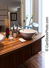 washbasin on a wooden shelf