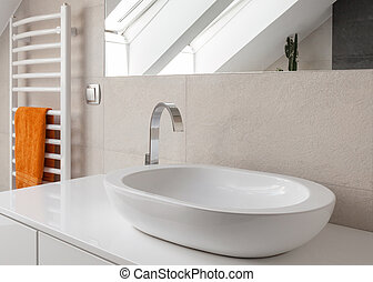 Washbasin with new design tap - Close up of oval washbasin ...