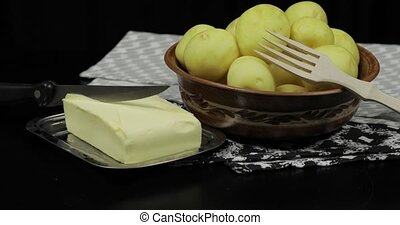 Washed fresh raw potatoes on a table ready for cooking....