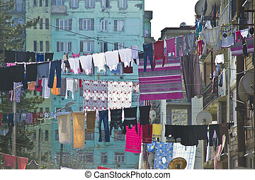 Washed laundry hanging in front of the facade in Batumi, Georgia