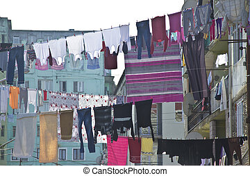 Washed laundry hanging in front of the windows of the facade in Batumi, Georgia
