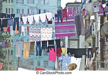 Washed laundry hangs in front of the facade in Batumi, Georgia
