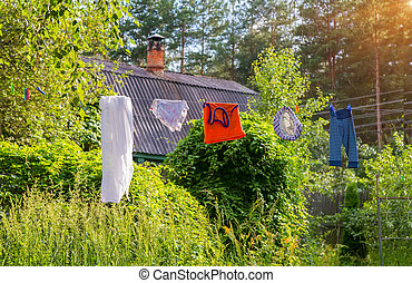 Washed laundry hangs on a rope