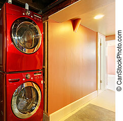 Washer and dryer in red in the basement