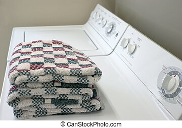 Washer and Dryer - A washer and dryer with folded towels