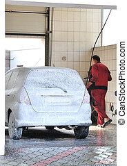 washerman washing Car at Car-wash service