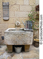 Washhouse with tools.