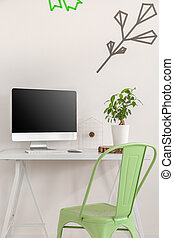 Cropped shot of a modern space for work with a washi tape decoration on the wall