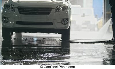 Washing a SUV car in the suds - car service