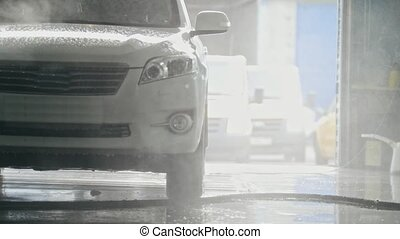 Washing a SUV car in the suds - car service, close up