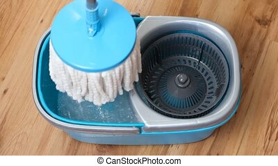 Washing and spinning the flat mop telescopic handle in a ...