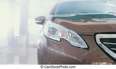 Washing automobile - sportcar in the suds by water hoses,...