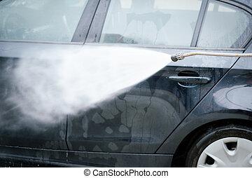 Washing car in a car wash self service station