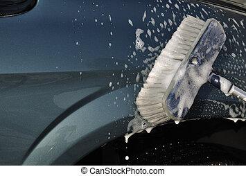 Washing Car with Scrub Brush, plenty of copy space
