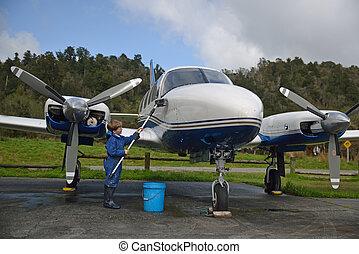 washing grandad's plane - 7-year-old boy washing his...