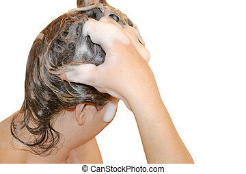 washing hair - woman cleans head and scalp with shampoo