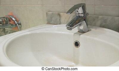 Washing hands in washbowl