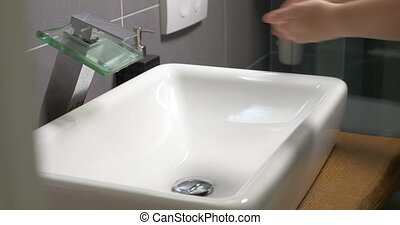 Washing hands in the bathroom