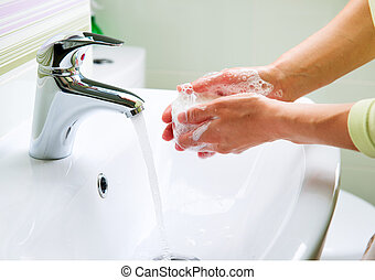 Washing Hands with Soap. Woman Cleaning Hands in a Bathroom