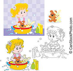 Washing - Little girl washing her toy bear and rabbit in a...