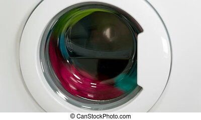 Washing machine is washing clothes, time lapse