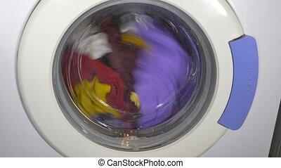 Washing machine turning - front view clothes - Washing...