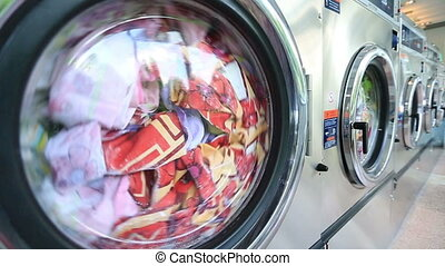 Washing machine washes laundry such as colored clothing, and...