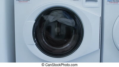 Washing machine washing clothes 4k - Washing machine washing...